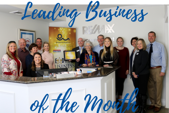 group photo of remax staff, chamber ambassadors and staff with words saying leading business