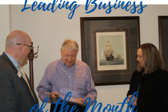 don leonard receiving plaque for leading business of the month